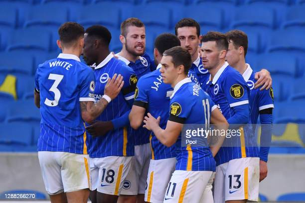 Pascal Gross of Brighton and Hove Albion celebrates with teammates after scoring his team's first goal during the Premier League match between...