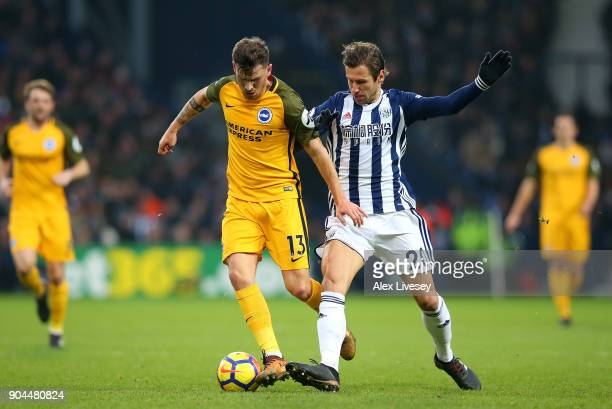 Pascal Gross of Brighton and Hove Albion is challenged by Grzegorz Krychowiak of West Bromwich Albion during the Premier League match between West...