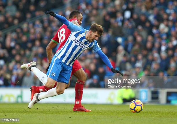 Pascal Gross of Brighton and Hove Albion is challenged by Jordan Ayew of Swansea City during the Premier League match between Brighton and Hove...