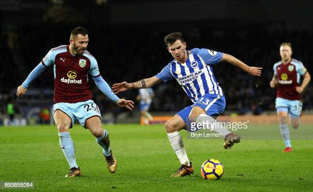 Pascal Gross of Brighton and Hove Albion is challenged by Phil Bardsley of Burnley during the Premier League match between Brighton and Hove Albion...