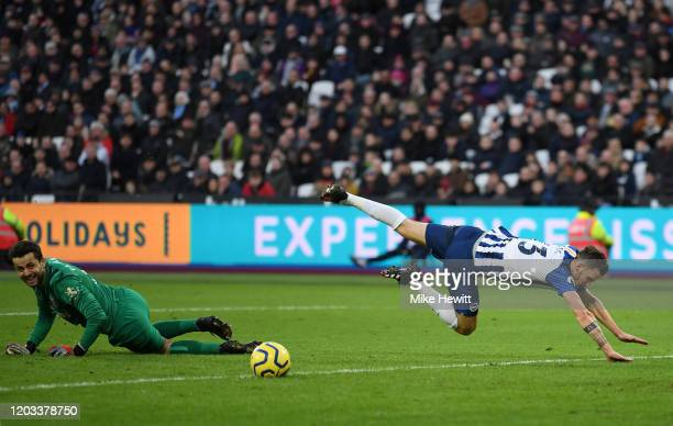 Pascal Gross of Brighton and Hove Albion is tripped by Lukasz Fabianski of West Ham United but goes on to score his sides second goal during the...