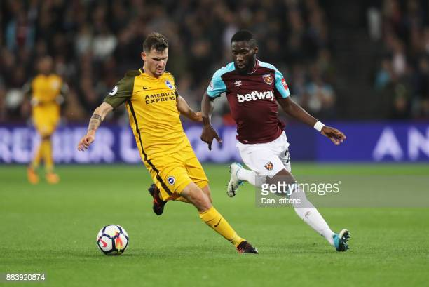 Pascal Gross of Brighton and Hove Albion is watched by Arthur Masuaku of West Ham United during the Premier League match between West Ham United and...