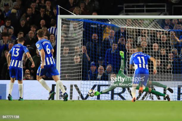 Pascal Gross of Brighton and Hove Albion scores a goal from the penalty spot during the Premier League match between Brighton and Hove Albion and...