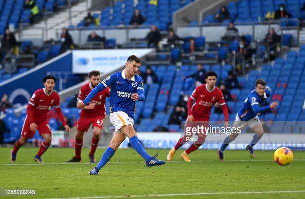 Pascal Gross of Brighton and Hove Albion scores a penalty for his team's first goal during the Premier League match between Brighton & Hove Albion...