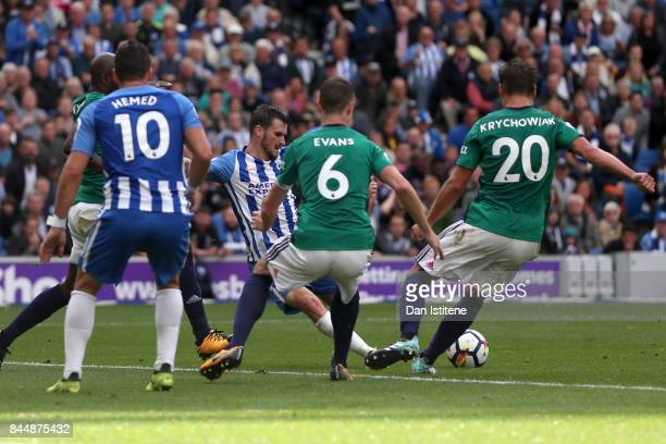 Pascal Gross of Brighton and Hove Albion scores his sides first goal during the Premier League match between Brighton and Hove Albion and West...