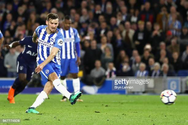 Pascal Gross of Brighton and Hove Albion scores his sides first goal from the penalty spot during the Premier League match between Brighton and Hove...