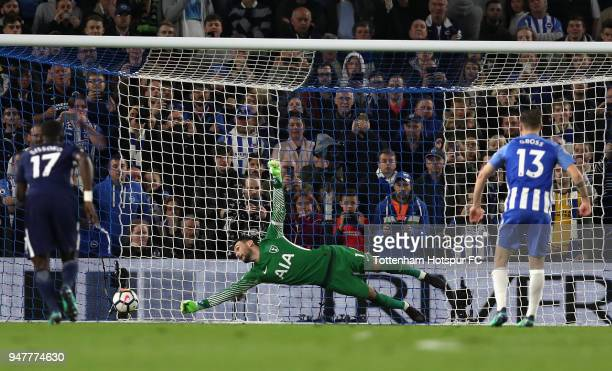 Pascal Gross of Brighton and Hove Albion scores his sides first goal from the penalty spot as Hugo Lloris of Tottenham Hotspur looks on during the...