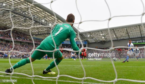 Pascal Gross of Brighton and Hove Albion scores his team's third goal from a penalty during the Premier League match between Brighton Hove Albion and...