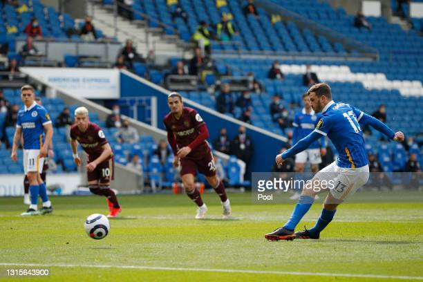 Pascal Gross of Brighton and Hove Albion scores their side's first goal from the penalty spot during the Premier League match between Brighton & Hove...