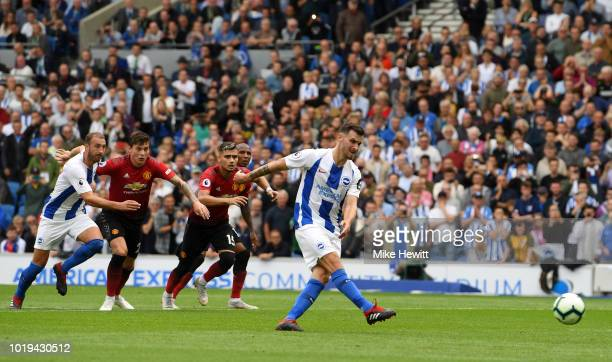 Pascal Gross of Brighton and Hove Albion shoots and scores his side's third goal from a penalty during the Premier League match between Brighton &...