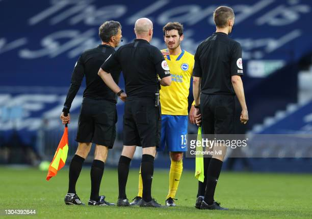 Pascal Gross of Brighton and Hove Albion speaks with referee Lee Mason following the Premier League match between West Bromwich Albion and Brighton &...
