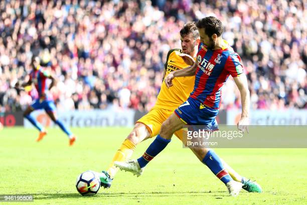 Pascal Gross of Brighton and Hove Albion tackles Yohan Cabaye of Crystal Palace during the Premier League match between Crystal Palace and Brighton...