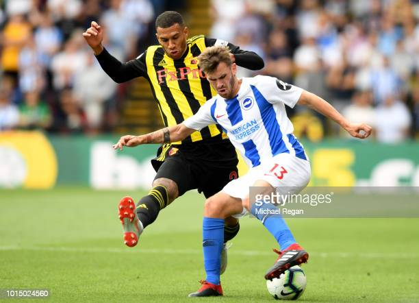 Pascal Gross of Brighton and Hove Albion turns with the ball under pressure from Etienne Capoue of Watford during the Premier League match between...