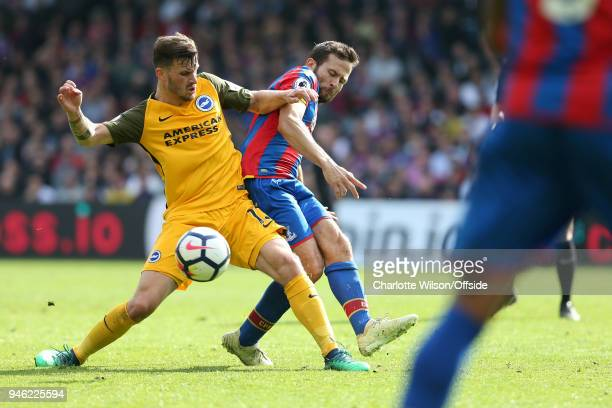 Pascal Gross of Brighton and Yohan Cabaye of Crystal Palace battle for the ball during the Premier League match between Crystal Palace and Brighton...