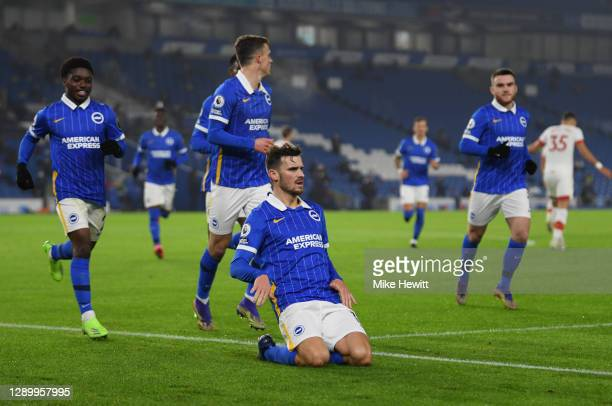 Pascal Gross of Brighton & Hove Albion celebrates after scoring their sides first goal from the penalty spot during the Premier League match between...
