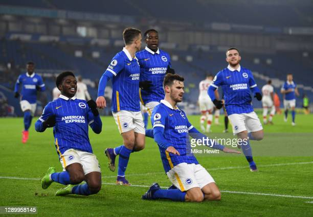 Pascal Gross of Brighton & Hove Albion celebrates after scoring their sides first goal from the penalty spot with Tariq Lamptey of Brighton & Hove...