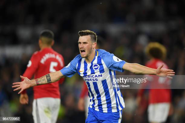 Pascal Gross of Brighton Hove Albion celebrates scoring the opening goal during the Premier League match between Brighton and Hove Albion and...