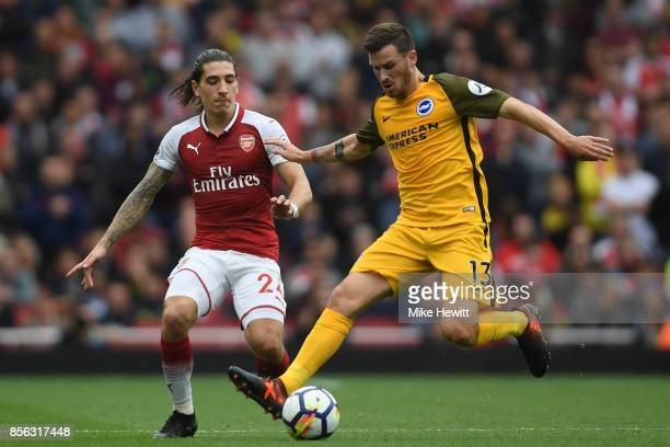 Pascal Gross of Brighton is challenged by Hector Bellerin of Arsenal during the Premier League match between Arsenal and Brighton and Hove Albion at...