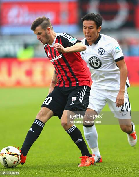 Pascal Gross of Ingolstadt battles for the ball with Makoto Hasebe of Frankfurt during the Bundesliga match between FC Ingolstadt and Eintracht...