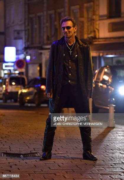 Pascal Grun local councillor and Johnny Hallyday fan and look alike poses on December 6 in Hayange eastern France France mourned on December 6 its...