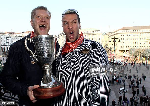 Pascal Hens and Johannes Bitter of Hamburg celebrate with the cup at the Hamburg townhall after winning the DHB German Cup final match between HSV...