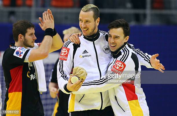 Pascal Hens and Patrick Groetzki of Germany celebrate the 24-23 victory after the Men's European Handball Championship group B match between...