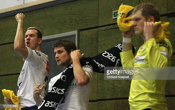 Pascal Hens, Michael Kraus and Johannes Bitter of Hamburg celebrate a goal during the Bundesliga match between VfL Gummersbach and HSV Hamburg at the...