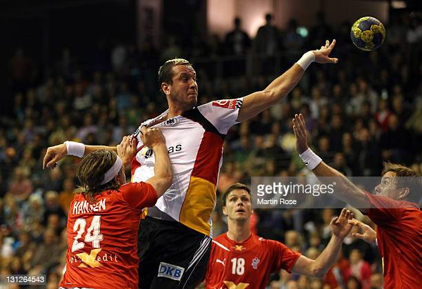 Pascal Hens of Germany and Mikkel Hansen of Denmark compete for the ball during the Mens'Handball Supercup match between Germany and Denmark at...