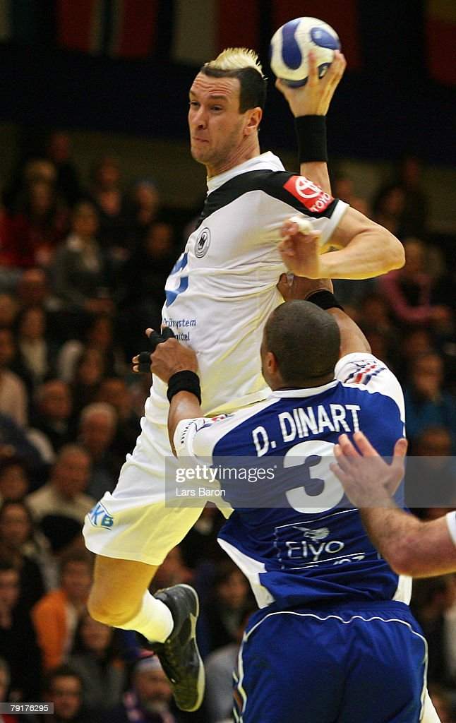 Pascal Hens of Germany in action with Didier Dinart of France during the Men's Handball European Championship main round Group II match between Spain and Sweden at Trondheim Spektrum on January 23, 2008 in Trondheim, Norway.