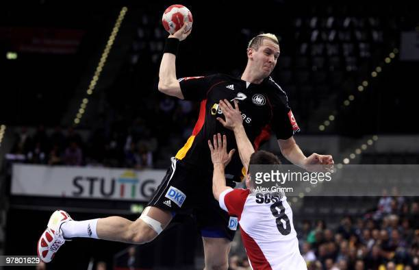 Pascal Hens of Germany is challenged by Andy Schmid of Switzerland during the international handball friendly match between Germany and Switzerland...
