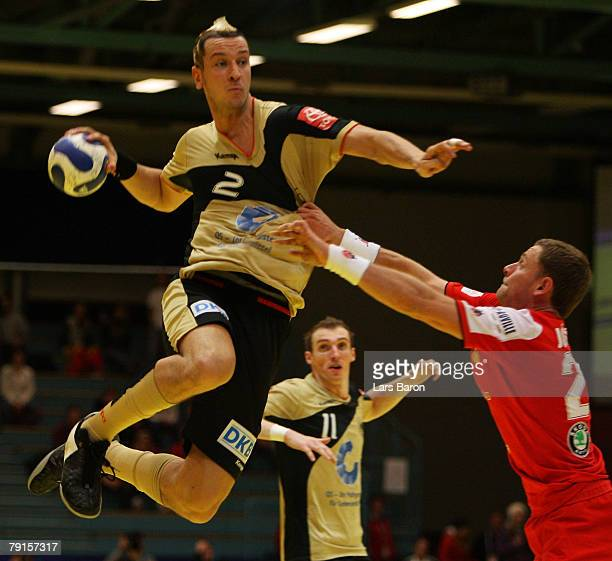Pascal Hens of Germany is seen in action with Hannes Jon Jonsson of Iceland during the Men's Handball European Championship main round Group II match...