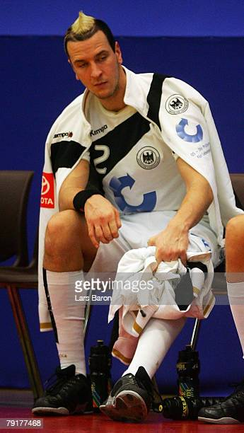 Pascal Hens of Germany sits injured on the bench during the Men's Handball European Championship main round Group II match between Germany and France...