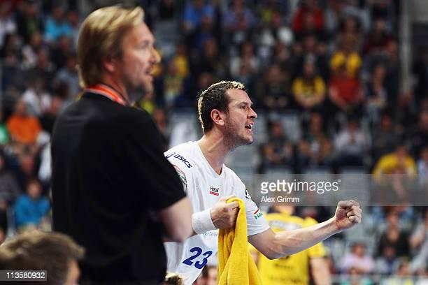 Pascal Hens of Hamburg celebrates after the Toyota Handball Bundesliga match between Rhein Neckar Loewen and HSV Hamburg at SAP Arena on May 3, 2011...