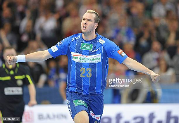 Pascal Hens of Hamburg celebrates during the EHF Champions League match between HSV Hamburg and Fuechse Berlin at the O2 World on March 25, 2012 in...
