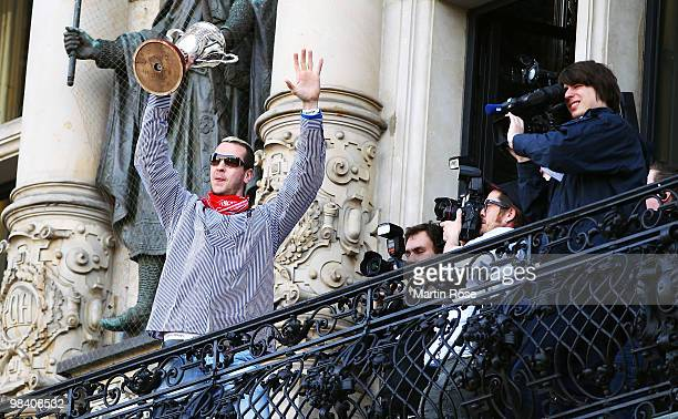 Pascal Hens of Hamburg celebrates with the cup at the Hamburg townhall after winning the DHB German Cup final match between HSV Handball and Rhein...