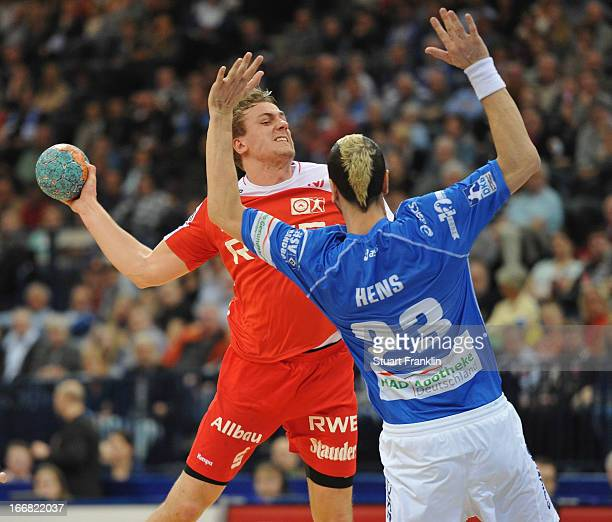 Pascal Hens of Hamburg challenges Niclas Pieczkowski of Essen during the DKB Bundesliga handball game between HSV Hamburg and TUSEM Essen at O2 World...