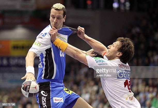Pascal Hens of Hamburg is attacked by Fabian van Olphen of Magdeburg during the Toyota Handball Bundesliga match between SC Magdeburg and HSV Hamburg...