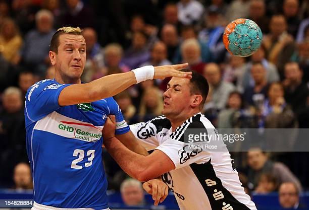 Pascal Hens of Hamburg is challenged by Marko Vujin of Kiel during the DKB Handball Bundesliga match between HSV Hamburg and THW Kiel at the O2 World...