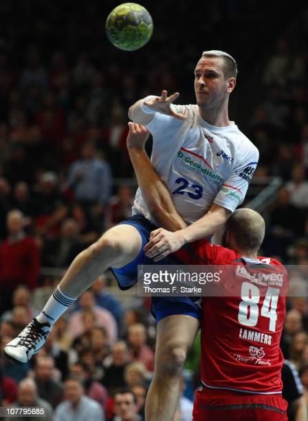 Pascal Hens of Hamburg is tackled by Thomas Lammers of Ahlen-Hamm during the Toyota Handball Bundesliga match between HSG Ahlen-Hamm and HSV Hamburg...