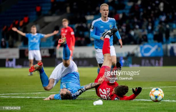 Pascal Itter of Chemnitz is challenged by Nils Miatke of Zwickau during the 3. Liga match between Chemnitzer FC and FSV Zwickau at Stadion an der...