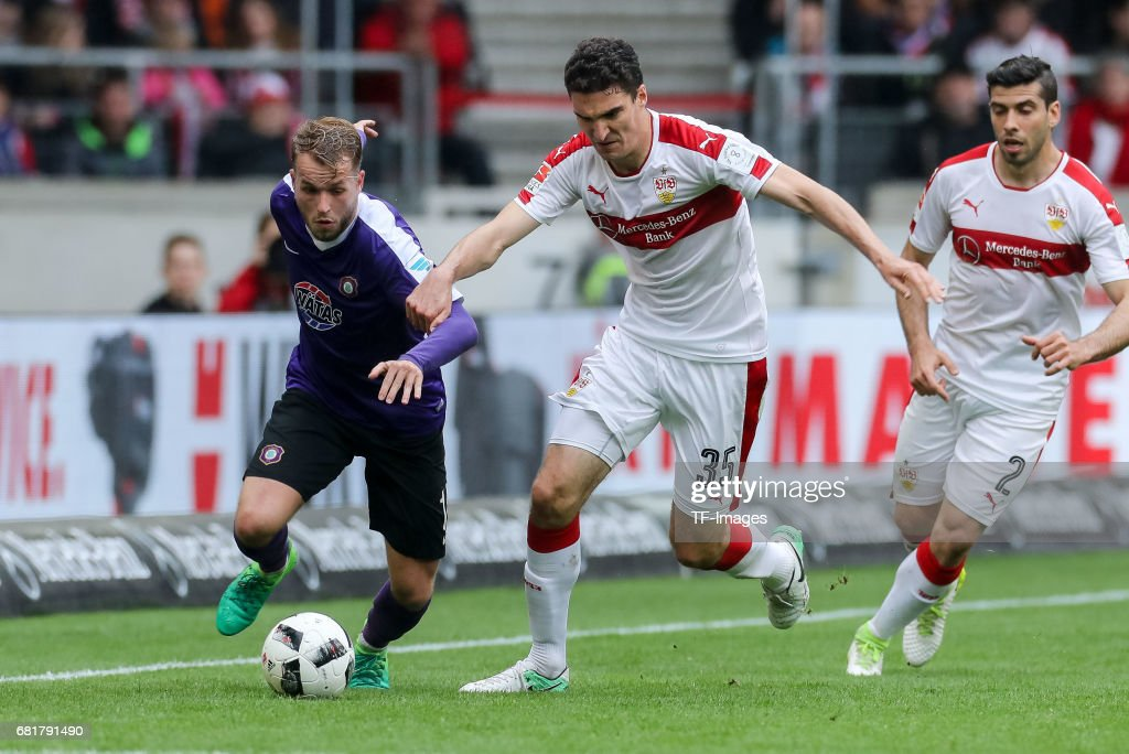 Pascal Koepke of Erzgebirge Aue and Marcin Kaminski of Stuttgart battle for the ball during the Second Bundesliga match between VfB Stuttgart and FC Erzgebirge Aue at Mercedes-Benz Arena on May 7, 2017 in Stuttgart, Germany.