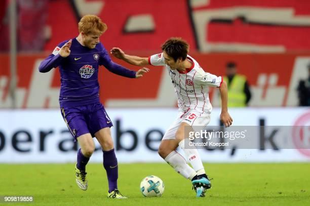 Pascal Koepke of Erzgebirge Aue challenges Genki Haraguchi of Duesseldorf during the Second Bundesliga match between Fortuna Duesseldorf and FC...