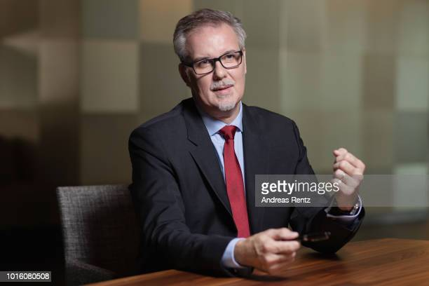 Pascal Laugel chief executive officer of TARGOBANK AG gestures while speaking during an interview as the bank announces second quarter earnings...
