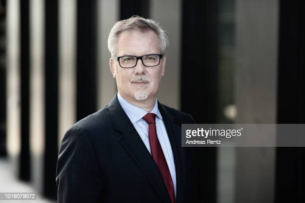 Pascal Laugel chief executive officer of TARGOBANK AG poses for a photograph ahead as the bank announces second quarter earnings figures on August 13...