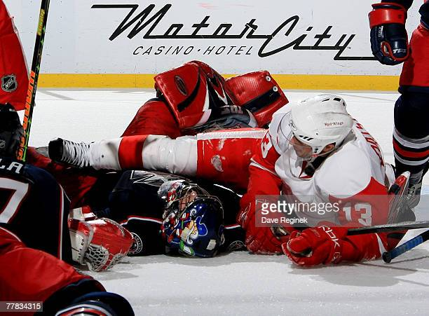 Pascal Leclaire of the Columbus Blue gets run over by Pavel Datsyuk the Detroit Red Wings during the NHL game on November 9 2007 at Joe Louis Arena...