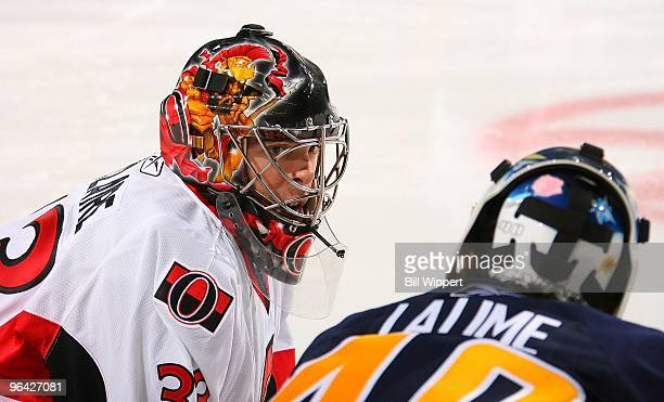 Pascal Leclaire of the Ottawa Senators and Patrick Lalime of the Buffalo Sabres chat on February 3, 2010 at HSBC Arena in Buffalo, New York.