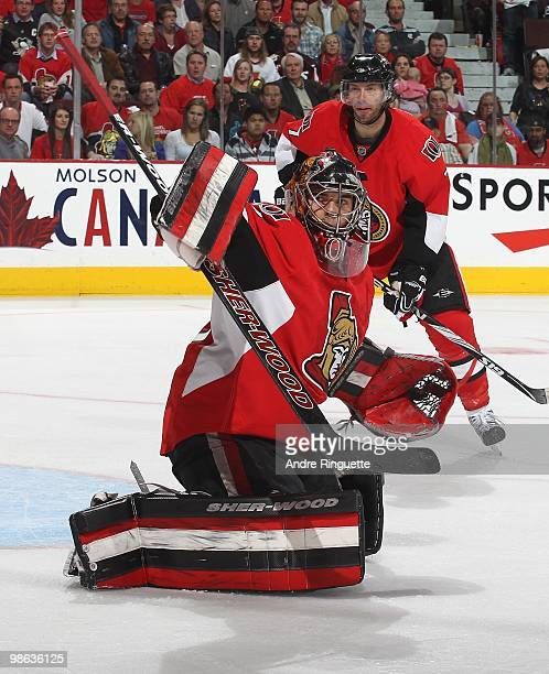 Pascal Leclaire of the Ottawa Senators makes a blocker save against the Pittsburgh Penguins as Matt Cullen looks on in Game Four of the Eastern...