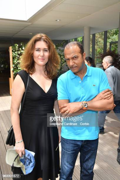Pascal Legitimus and and his wife Adriana Santini attend the 2018 French Open Day Two at Roland Garros on May 28 2018 in Paris France
