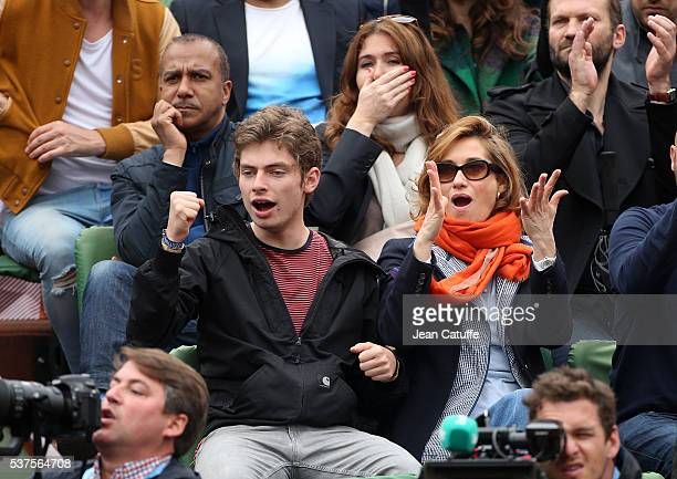 Pascal Legitimus and his wife Adriana Santini below them Emmanuelle Devos with her son Raphael attend day 11 of the 2016 French Open held at...