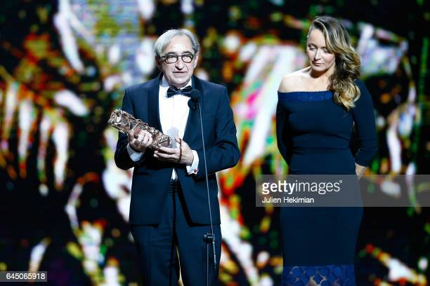 Pascal Marti receives the Cesar of Best Cinematography for 'Frantz' given by Julie Ferrier during the Cesar Film Awards Ceremony at Salle Pleyel on...